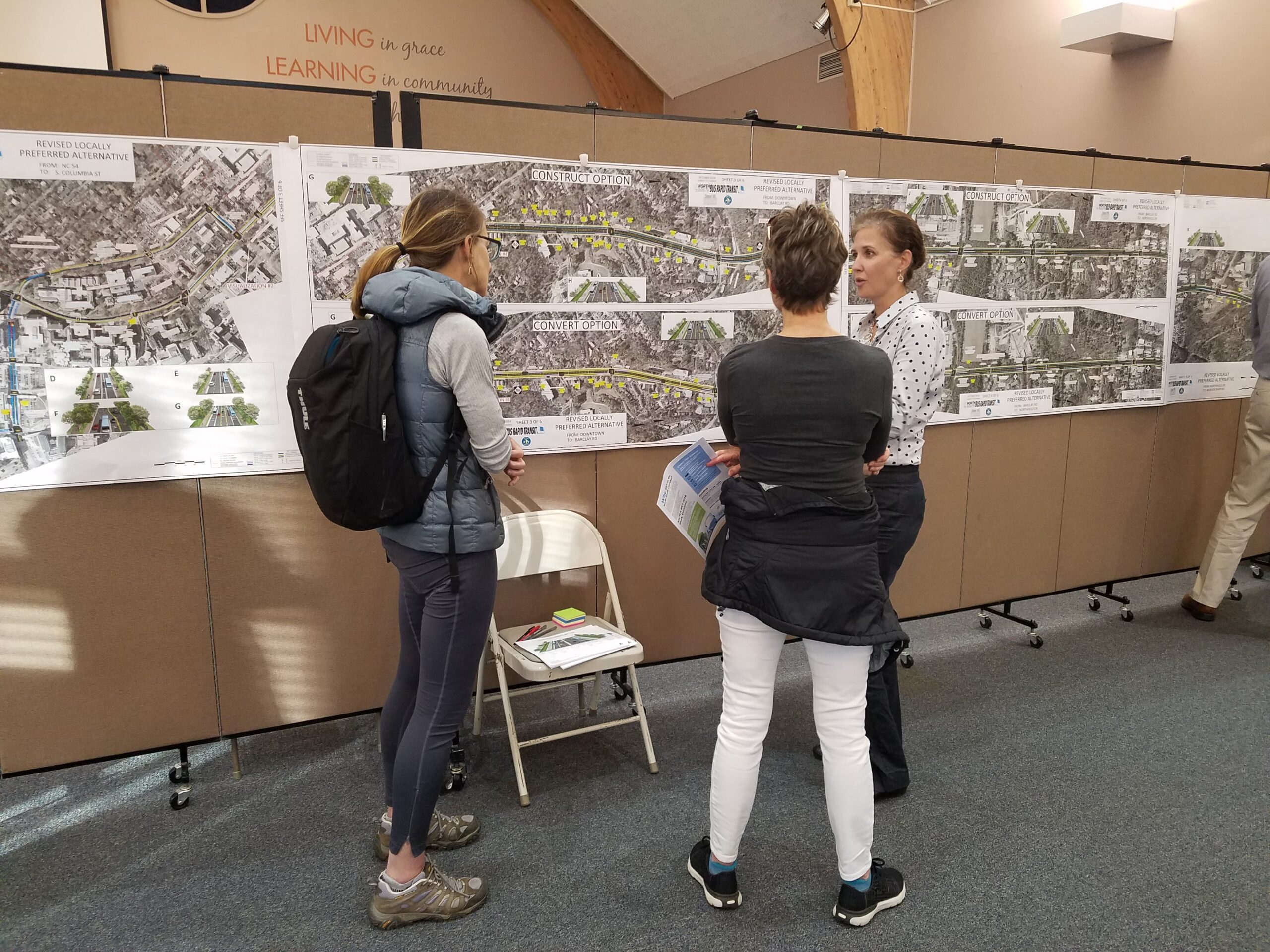 Project team reviewing roadway plans at the third Open House.