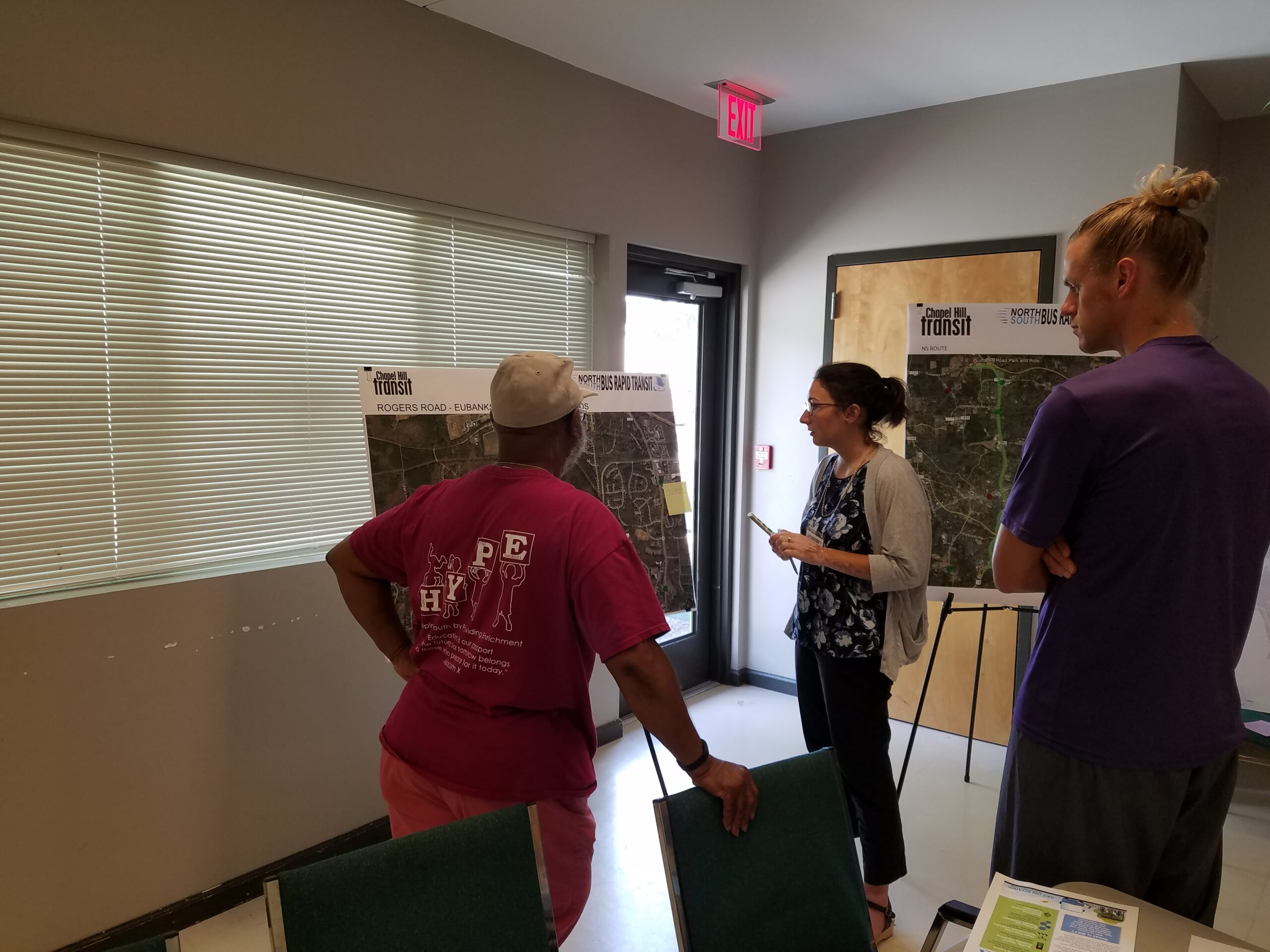 Members of the Rogers-Eubanks Neighborhood reviewing project materials at a project meeting.