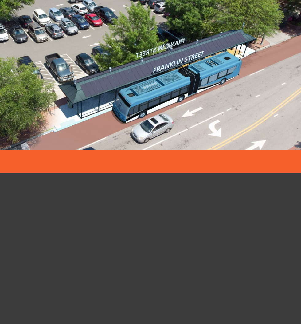 Rendering of an articulated North-South Bus Rapid Transit Bus parked at a station on Franklin Street.