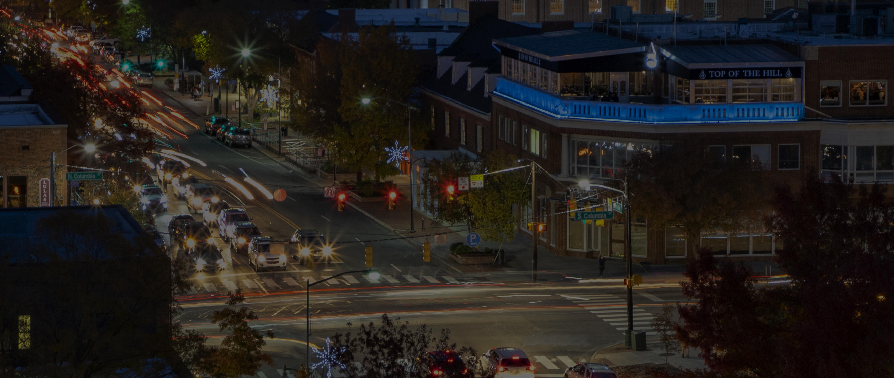 Evening traffic traveling through Downtown Chapel Hill.